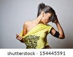 beautiful fitness woman  studio ... | Shutterstock . vector #154445591