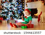 Child Opening Present At...
