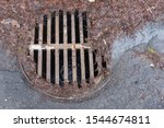Manhole Surrounded By Dirty...