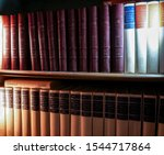 Small photo of Albi, France - Oct. 2019 - Volumes of encyclopedic dictionaies in the bookshelf of a library, including French-language versions of the Encyclopaedia Universalis and Larousse ones with leather cover