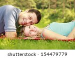 a couple in love outdoors lying ... | Shutterstock . vector #154479779