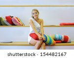 a young woman sitting on white... | Shutterstock . vector #154482167