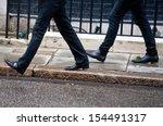 two men walk together. concept... | Shutterstock . vector #154491317