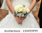bride holding white wedding... | Shutterstock . vector #154493999