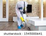 Exterminator in work wear...