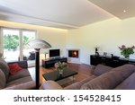 Bright space - a comfortable and cosy living room - stock photo