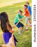 Group Of Kids Playing Tug Of...