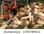 Person Splitting Firewood On A...