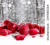Red Christmas Balls In Snowed ...