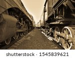 Between Cars Of Old Trains ...