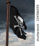 tattered pirate flag flying... | Shutterstock . vector #154586555