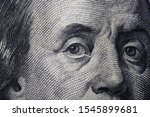 Small photo of Franklin eyes macro. The texture of the fragment of the dollar bill. USD banknote texture. One hundred American dollars. Can inform about fiscal and monetary policy of the country, currency inflati