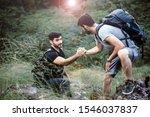 Backpackers Men Getting Help To ...