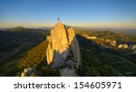 A Climber At The Summit Of A...