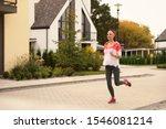 Beautiful Sporty Woman Running...
