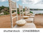 Stock photo baskets with white flowers roses petals for wedding on the chairs petals at the wedding ceremony 1546088864