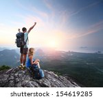hikers relaxing on top of a... | Shutterstock . vector #154619285