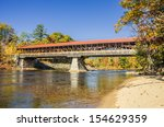 covered bridge in autumn and...