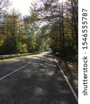autumn road in the forest... | Shutterstock . vector #1546555787