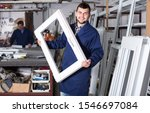Small photo of Workman is demonstrating PVC manufacturing output in workshop.