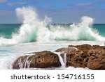 Sea Waves Crashing Against The...