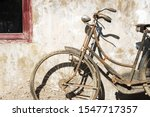 Old Bicycle Lay On Brick With...