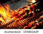 delicious beef bbq on grill | Shutterstock . vector #154802639