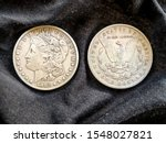 Two Morgan Dollars  Showing...