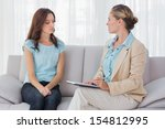 woman listening to her...   Shutterstock . vector #154812995