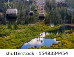 Breckenridge, Colorado / USA: August 31, 2019: Image taken while riding the BreckConnect Gondola to Peak 8 to explore Epic Discovery in the summer. Dark blue skies reflected in small puddle on ground - stock photo