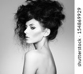 Black and white photo of beautiful woman with magnificent hair. Fashion photo - stock photo