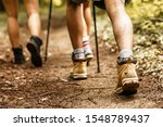 People Hiking.only Legs And...