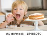 boy grabbing at cake at home | Shutterstock . vector #15488050