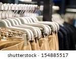 clothes on hangers close up | Shutterstock . vector #154885517