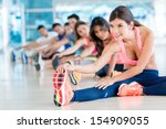 group of fit people at the gym... | Shutterstock . vector #154909055