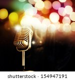 microphone in front of bright... | Shutterstock . vector #154947191