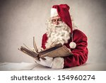 Santa Claus Reads Old Book