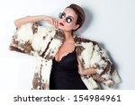 fashionable beautiful woman... | Shutterstock . vector #154984961