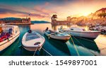 Great evening view of Gulf of Corinth, Greece, Europe. Attractive sunset on popular touristic destination - Nafpaktos port. Calm seascape of Ionian sea. Traveling concept background.