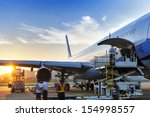 airplane near the terminal in... | Shutterstock . vector #154998557