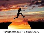 Man Jump Through The Gap On...