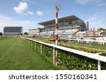 Small photo of DONCASTER RACECOURSE, STH YORKSHIRE, UK : 13 SEPTEMBER 2019 : A general view of the home straight, grandstands and racecourse hotel under crisp blue skies from the half furlong pole at Doncaster Races