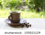 Brown Cup Of Coffe On Wooden...