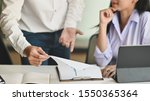 Small photo of Businessman Explain business chart board with partner female.