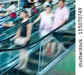 people rush on escalator motion ... | Shutterstock . vector #155070749