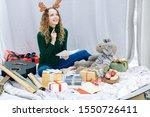 Stock photo smiling creative young woman writing christmas poem in greeting card for friend 1550726411