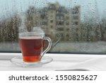 Glass Cup Of Tea On Windowsill  ...