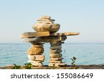 an inukshuk on a shore of lake... | Shutterstock . vector #155086649