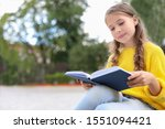 Cute Little Girl Reading Book...