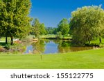 lake at the beautiful golf... | Shutterstock . vector #155122775